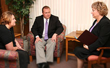 Two people meeting with a Cedar Memorial counselors