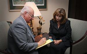 Woman meeting with Cedar Memorial Staff member